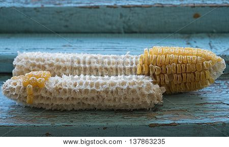 Dried Corn On Blue Wood Background