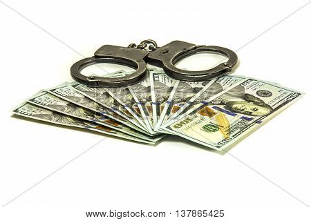 Hundred dollar American banknote and metal handcuffs