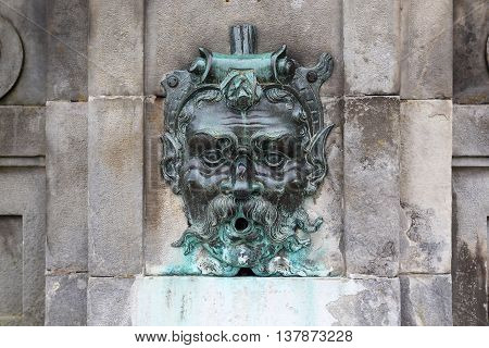 FONTAINEBLEAU, FRANCE - MAY 16, 2015: It is fragment one of the fountains in the Foutain Courtyard in chateau Fontainbleau.