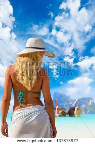 Woman on the tropical beach in Thailand
