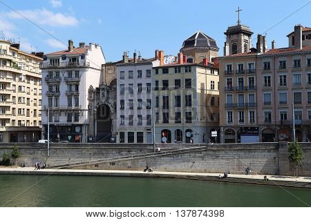 LYON, FRANCE - MAY 24, 2015: This is quay of the Saone river with a view of Notre-Dame-Saint-Vincent.