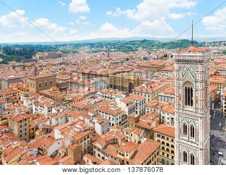 bell tower of cathedral church Santa Maria del Fiore and cityscape of Florence, Italy