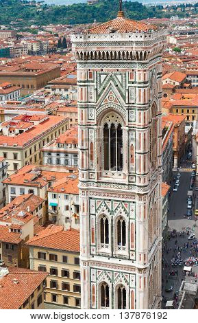 bell tower of cathedral Santa Maria del Fiore with roofs of old town, Florence, Italy