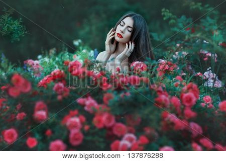 Woman outdoors among the reds she naked.