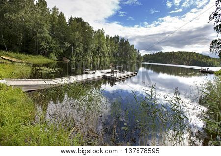 The mooring on the forest lake. Finland