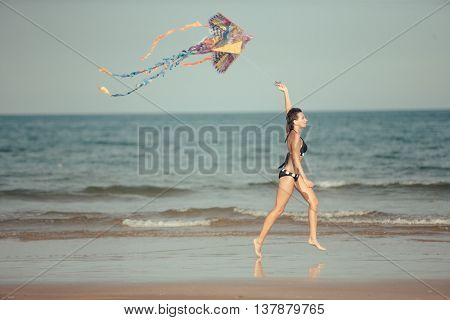 Beautiful Woman Playing with Kite on Tropical Beach