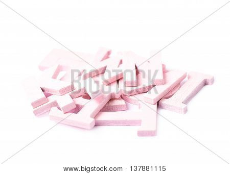 Pile of colorful paint coated wooden letters isolated over the white background