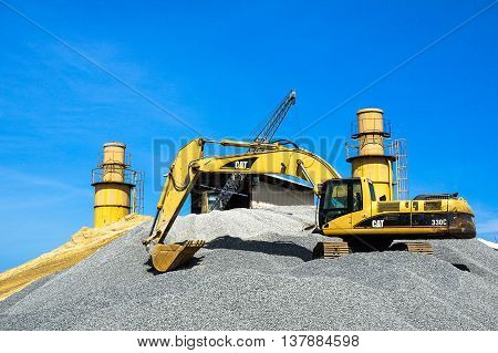 Labuan,Malaysia-July 10,2016-A view of industrial equipment with excavator and gravel image for quarrying at Rancha-rancha Industrial Area,Labuan island on 10th July 2016.
