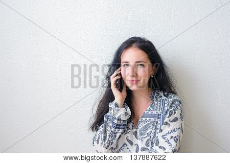 Woman Wearing An Colore Shirt Using A Mobile Phone