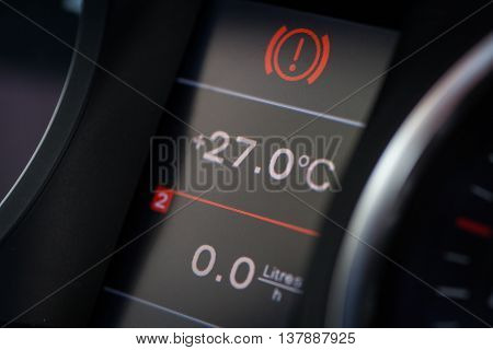 Image of a car's dashboard displaying parking light alert icon.
