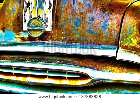 A close up abstract view of the front grill on an old scrap car in HDR