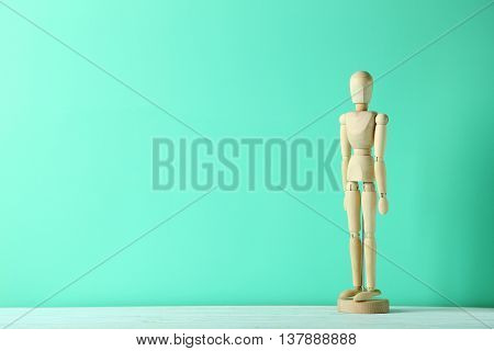 Wooden figure on a green wooden table