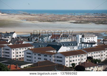 Color landscape in Jersey island with houses and beach.