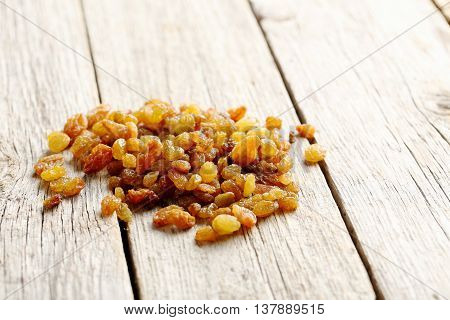 Dried Raisins On A Grey Wooden Table