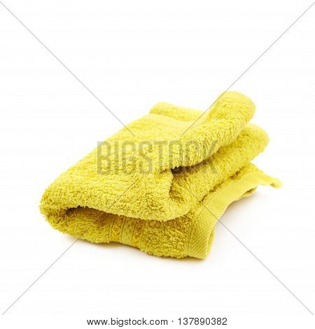 Crumpled yellow kitchen towel isolated over the white background