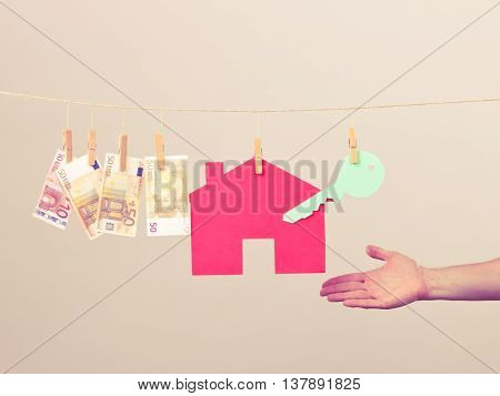 Male Hand Showing House And Money