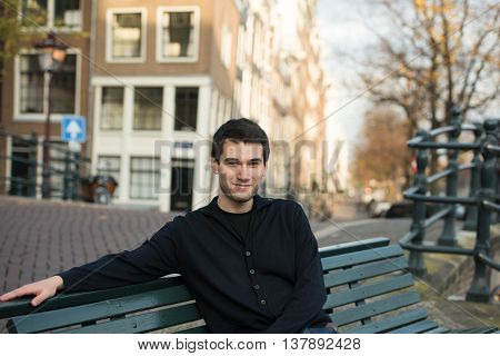 man in sitting on the bench in Amsterdam Netherland