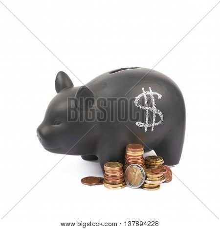 USD dollar symbol written with chalk on a black ceramic piggy bank coin container next to a pile of euro coins, composition isolated over the white background
