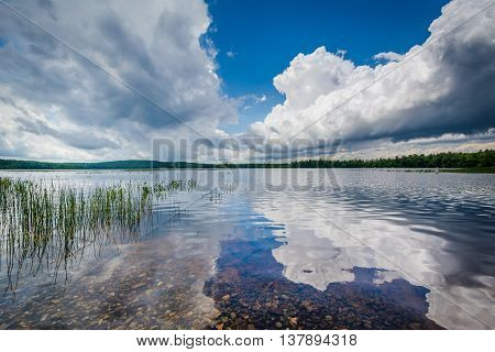 Dramatic Storm Clouds Reflecting In Massabesic Lake, In Auburn, New Hampshire.