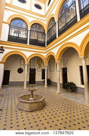 SEVILLE, SPAIN - September 12, 2015: Detail of the interior patio of the House of Trade in the Alcazar of Seville on September 12, 2015 in Seville, Spain