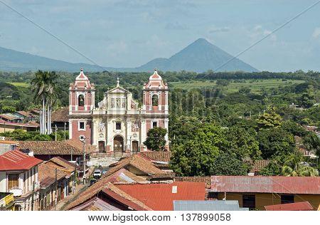 Church facade with volcano in Leon Nicaragua