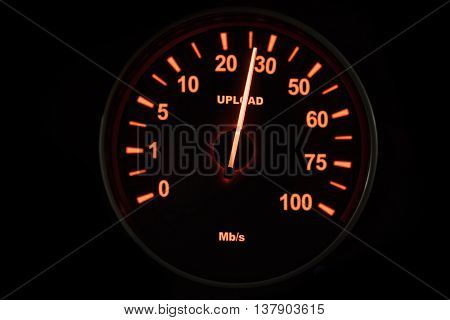 Image of a speedometer testing the uploading process with speed up to 26 Mbps