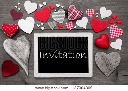 Chalkboard With English Text Invitation. Many Red Textile Hearts. Grey Wooden Background With Vintage, Rustic Or Retro Style. Black And White Style With Colored Hot Spots