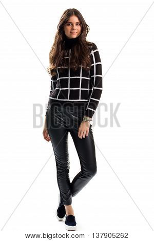 Woman in black checkered sweatshirt. Slip ons and trousers. Casual apparel for autumn. Brand new leather pants.