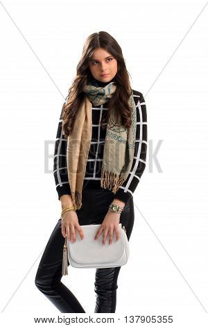 Girl wears sweater and scarf. Beige scarf with print. Casual outfit for autumn weather. Nice accessories and clothes.