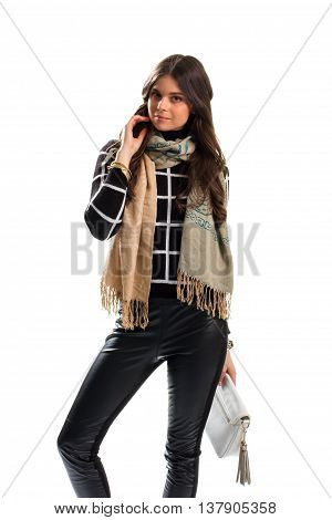Woman wears beige scarf. Skinny pants and sweatshirt. New wear and stylish accessories. Feel comfortable this autumn.