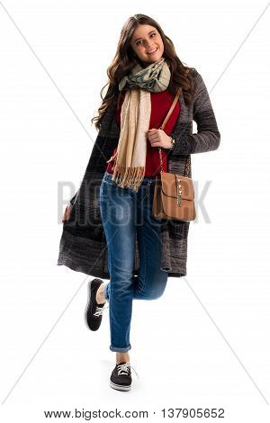 Woman in sweater coat. Brown handbag and blue jeans. Autumn outfit with stylish scarf. New outerwear and accessories.