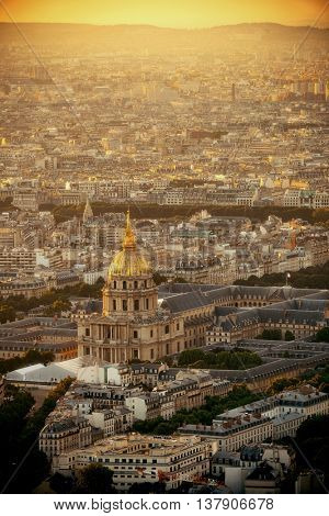 Paris city rooftop view with Napoleon's tomb at sunset.