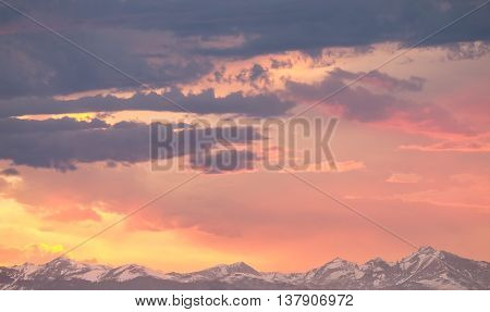 Magical Colors Paint the tops of the Rocky Mountains at Sunrise