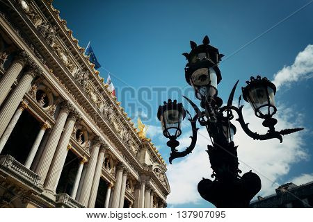 Palais Garnier with vintage lamp viewed from street in Paris.