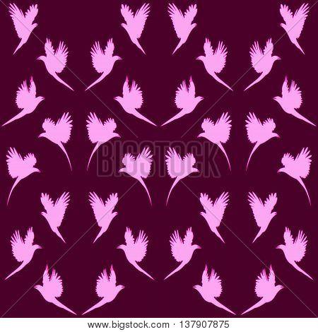 Hummingbirds. Pattern of pink birds on a purple background