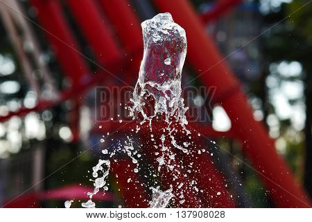 abstract figure of a water fountain on blurred background