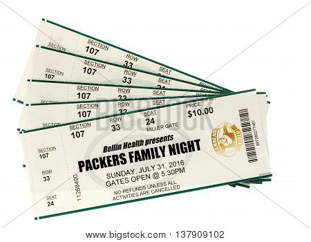 Winneconnie WI - 10 July 2016: Green Bay Packer tickets to family night on an isolated background.