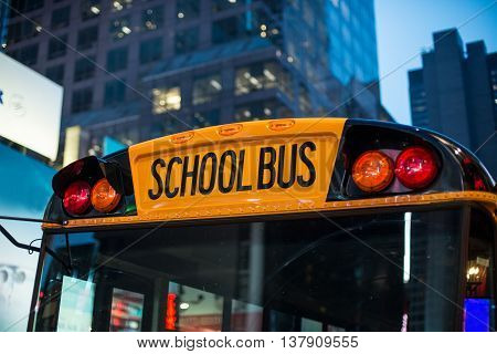 School bus children educational transport sitting in the parking at the night in New York City street