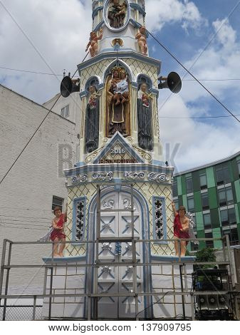 Traditional Italian Giglio Parade 113th anniversary Catholic Parade, Williamsburg, Brooklyn, 2016: men carry one-ton steel tower from Our Lady of Mount Carmel Parish