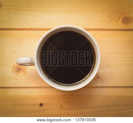 cup of coffee on a wooden table close