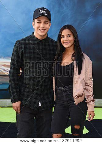 LOS ANGELES - JUL 9:  Austin Mahone & Katya Henry arrives to the