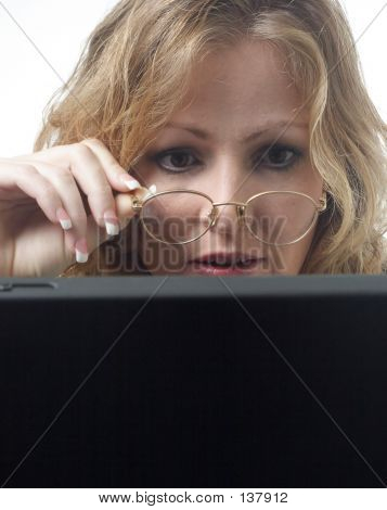 Business Woman Looking Closely At Laptop