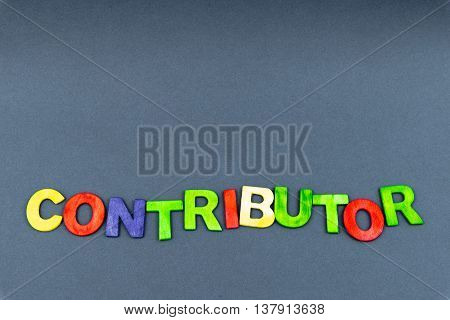 Word Contributor Created Of Wood Letters On Dark Background