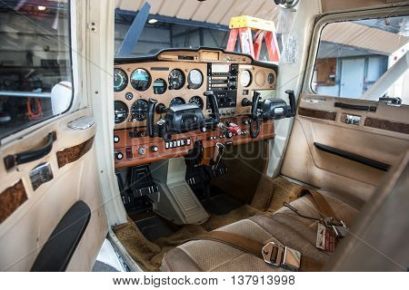 Small private plane pilot cabin with avionics equipment