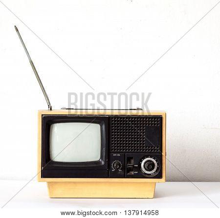 Vintage Yellow TV on white table
