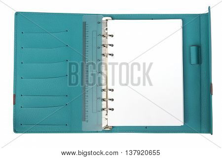 A blue notebook with white blank page
