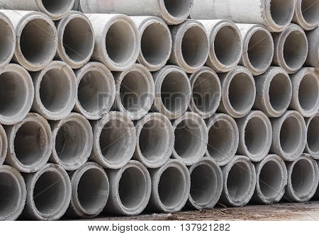 Stack of Cement pipes for drainage and construction