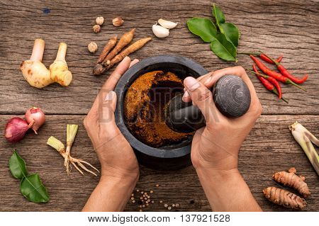 The Women Hold Pestle With Mortar And Spice Red Curry Paste Ingredient Of Thai Popular Food On Rusti
