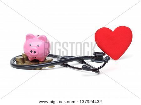 a stethoscope with piles of coins, red heart, and piggy bank - healthcare cost concept