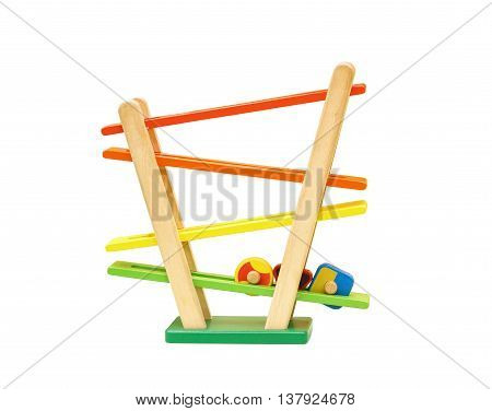 Toy for young kids. Wooden toy with shapes rolling from the top to buttom
